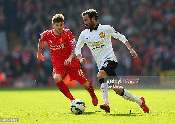 Juan Mata of Manchester United is closed down by Alberto Moreno of Liverpool during the Barclays Premier League match between Liverpool and...