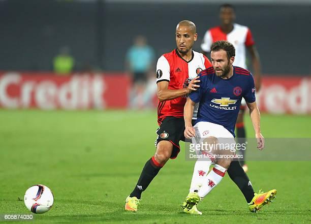 Juan Mata of Manchester United is put under pressure by Karim El Ahmadi of Feyenoord during the UEFA Europa League Group A match between Feyenoord...