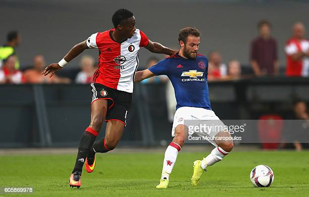 Juan Mata of Manchester United is put under pressure by Terence Kongolo of Feyenoord during the UEFA Europa League Group A match between Feyenoord...