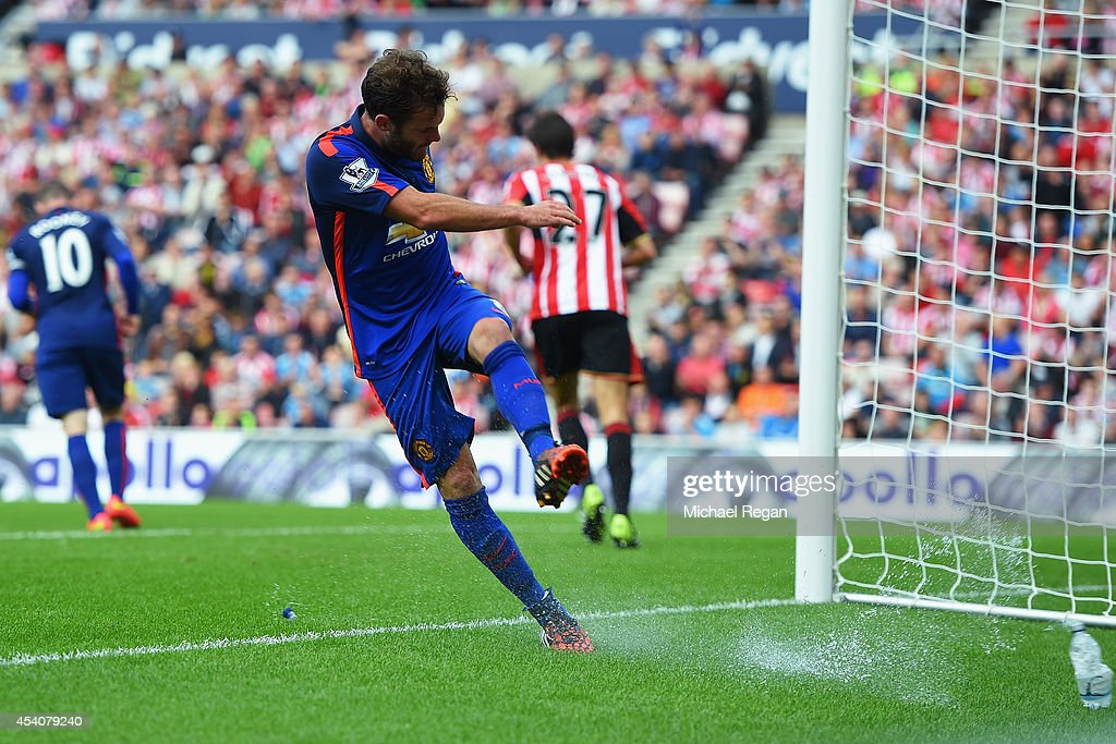Juan Mata of Manchester United kicks a water bottle in frustration during the Barclays Premier League match between Sunderland and Manchester United at Stadium of Light on August 24, 2014 in Sunderland, England.