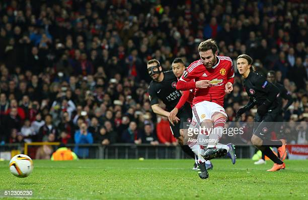 Juan Mata of Manchester United kicks the penalty saved by Mikkel Andersen of Midtjylland during the UEFA Europa League Round of 32 second leg match...