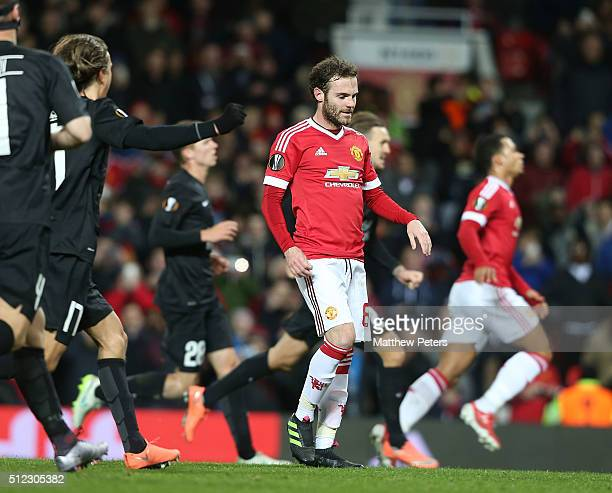 Juan Mata of Manchester United reacts to having a penalty saved during the UEFA Europa League match between Manchester United and FC Midtjylland at...