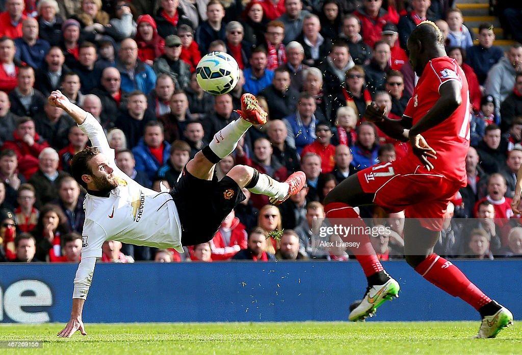 Juan Mata of Manchester United scores his second goal during the Barclays Premier League match between Liverpool and Manchester United at Anfield on...