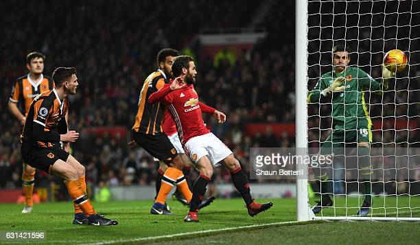 Juan Mata of Manchester United scores his sides first goal during the EFL Cup SemiFinal First Leg match between Manchester United and Hull City at...