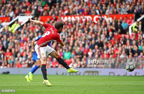 Juan Mata of Manchester United scores his sides second goal during the Premier League match between Manchester United and Leicester City at Old...