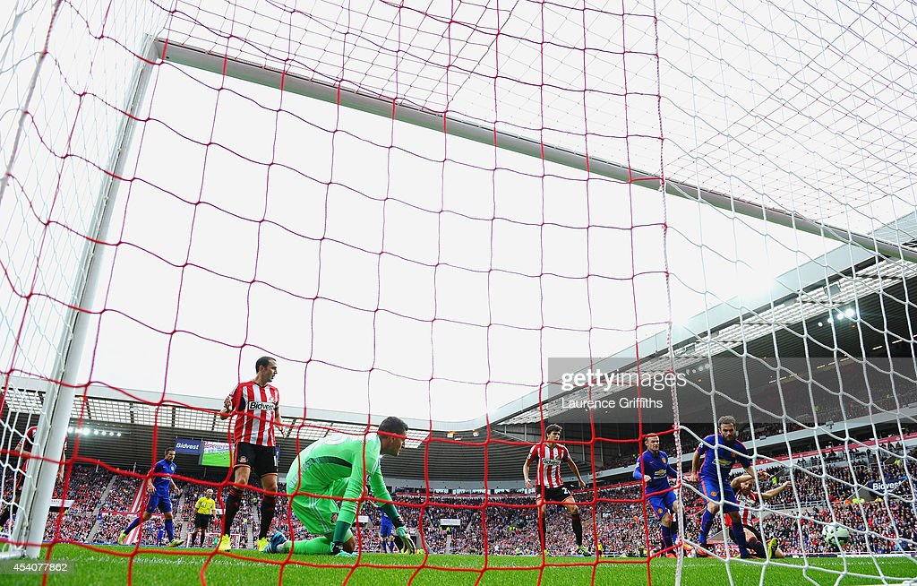 Juan Mata of Manchester United scores the opening goal during the Barclays Premier League match between Sunderland and Manchester United at Stadium of Light on August 24, 2014 in Sunderland, England.