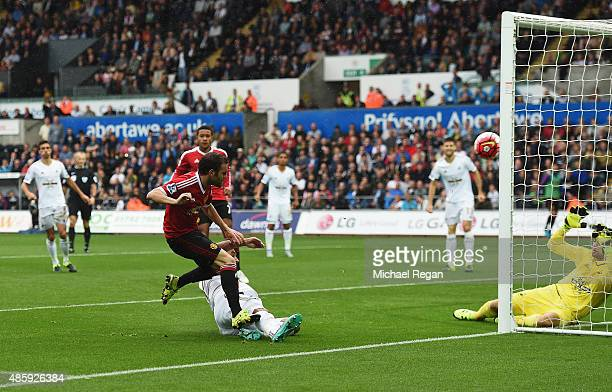 Juan Mata of Manchester United scores the opening goal during the Barclays Premier League match between Swansea City and Manchester United at Liberty...
