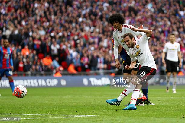 Juan Mata of Manchester United scores their first goal during The Emirates FA Cup Final match between Manchester United and Crystal Palace at Wembley...