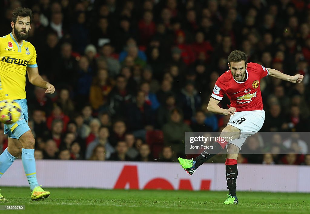 Juan Mata of Manchester United scores their first goal during the Barclays Premier League match between Manchester United and Crystal Palace at Old Trafford on November 8, 2014 in Manchester, England.