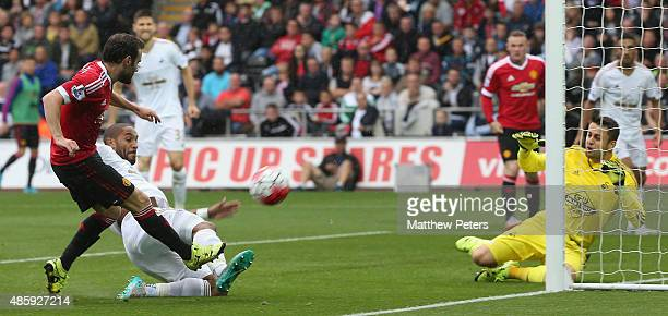 Juan Mata of Manchester United scores their first goal during the Barclays Premier League match between Swansea City and Manchester United at Liberty...