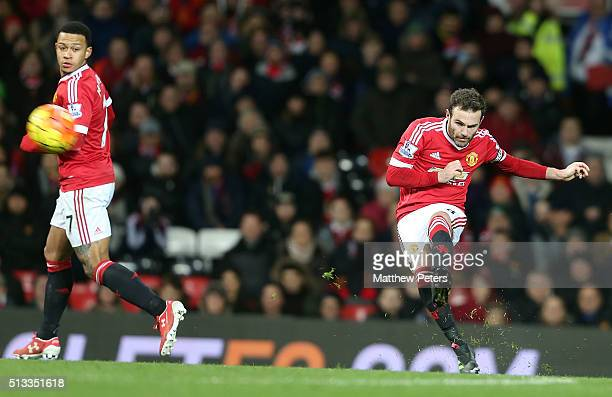 Juan Mata of Manchester United scores their first goal during the Barclays Premier League match between Manchester United and Watford at Old Trafford...