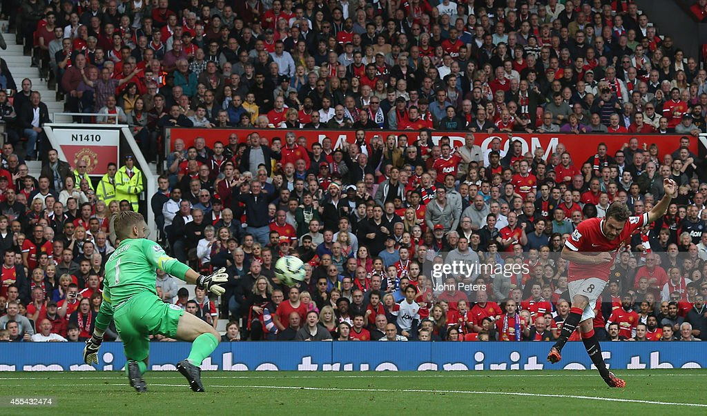Juan Mata of Manchester United scores their fourth goal during the Barclays Premier League match between Manchester United and Queens Park Rangers at Old Trafford on September 14, 2014 in Manchester, England.