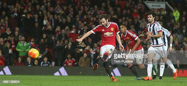 Juan Mata of Manchester United scores their second goal during the Barclays Premier League match between Manchester United and West Bromwich Albion...