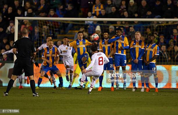 Juan Mata of Manchester United scores to make it 02 during the Emirates FA Cup match between Shrewsbury Town and Manchester United at New Meadow on...
