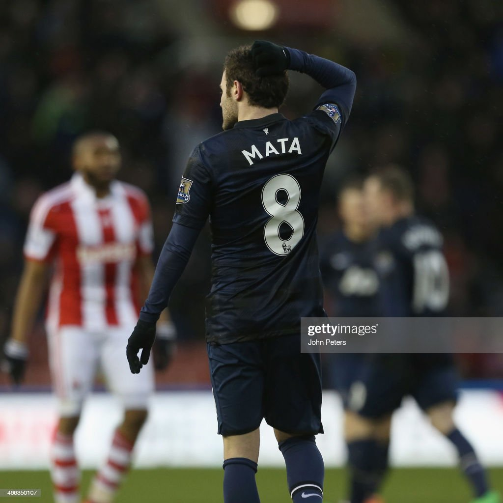 Juan Mata of Manchester United shows his disappointment after the Barclays Premier League match between Stoke City and Manchester United at Britannia Stadium on February 1, 2014 in Stoke on Trent, England.
