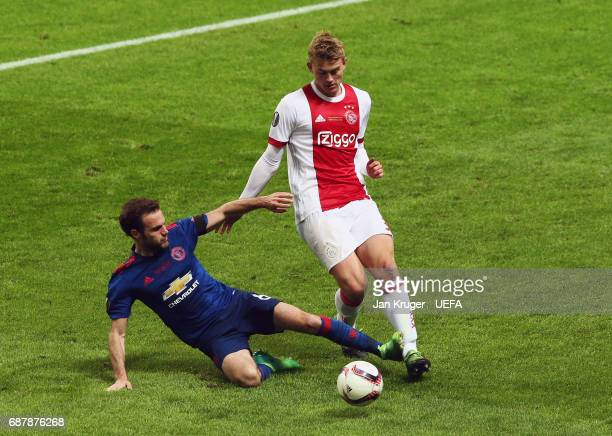 Juan Mata of Manchester United tackles Matthijs de Ligt of Ajax during the UEFA Europa League Final between Ajax and Manchester United at Friends...