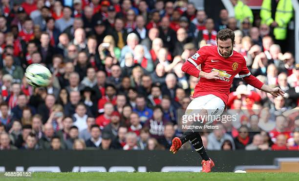 Juan Mata of Manchester United takes a free kick during the Barclays Premier League match between Manchester United and Aston Villa at Old Trafford...