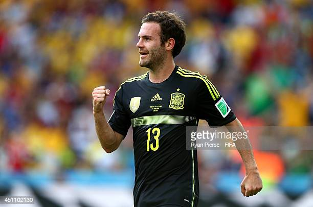 Juan Mata of Spain celebrates scoring his team's third goal during the 2014 FIFA World Cup Brazil Group B match between Australia and Spain at Arena...