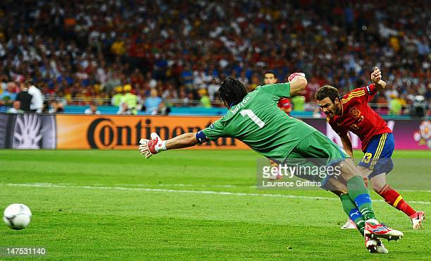 Juan Mata of Spain scores his team's fourth goal past Gianluigi Buffon of Italy during the UEFA EURO 2012 final match between Spain and Italy at the...