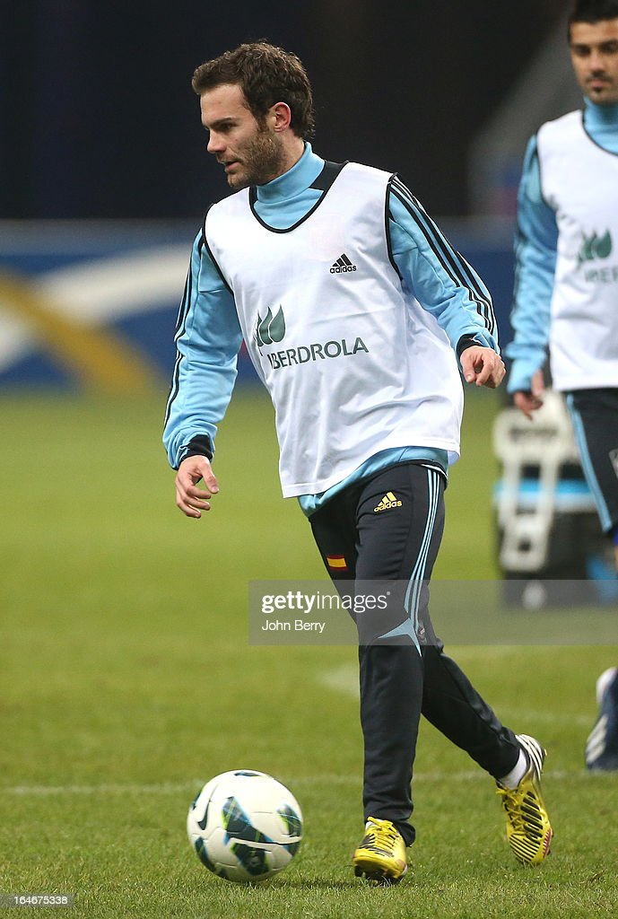 <a gi-track='captionPersonalityLinkClicked' href=/galleries/search?phrase=Juan+Mata&family=editorial&specificpeople=4784696 ng-click='$event.stopPropagation()'>Juan Mata</a> of Spain warms up during the practice session the day before the FIFA World Cup 2014 qualifier between France and Spain at the Stade de France on March 25, 2013 in Saint-Denis near Paris, France.