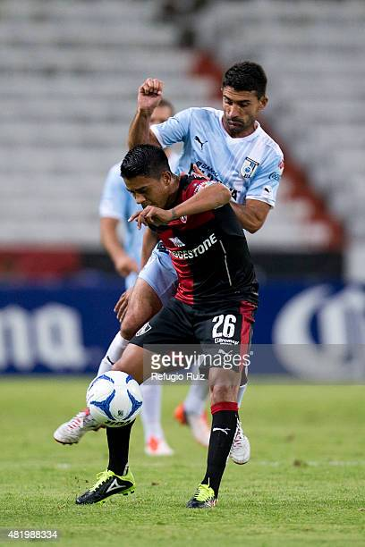 Juan Medina of Atlas fights for the ball with Antonio Nelson of Querétaro during a 1st round match between Atlas and Queretaro as part of the...