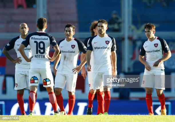 Juan Mercier Ruben Botta and Matias Caruzzo of San Lorenzo leave the field at the end of the first half during a match between San Lorenzo and...