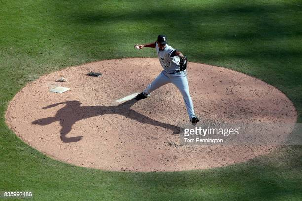 Juan Minaya of the Chicago White Sox pitches against the Texas Rangers in the bottom of the ninth inning at Globe Life Park in Arlington on August 20...