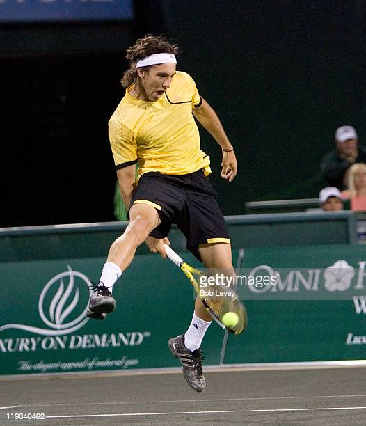 Juan Monaco hits a return against JanMichael Gambill during match action Juan Monaco defeated JanMichael Gambill 7564 in during first round action at...
