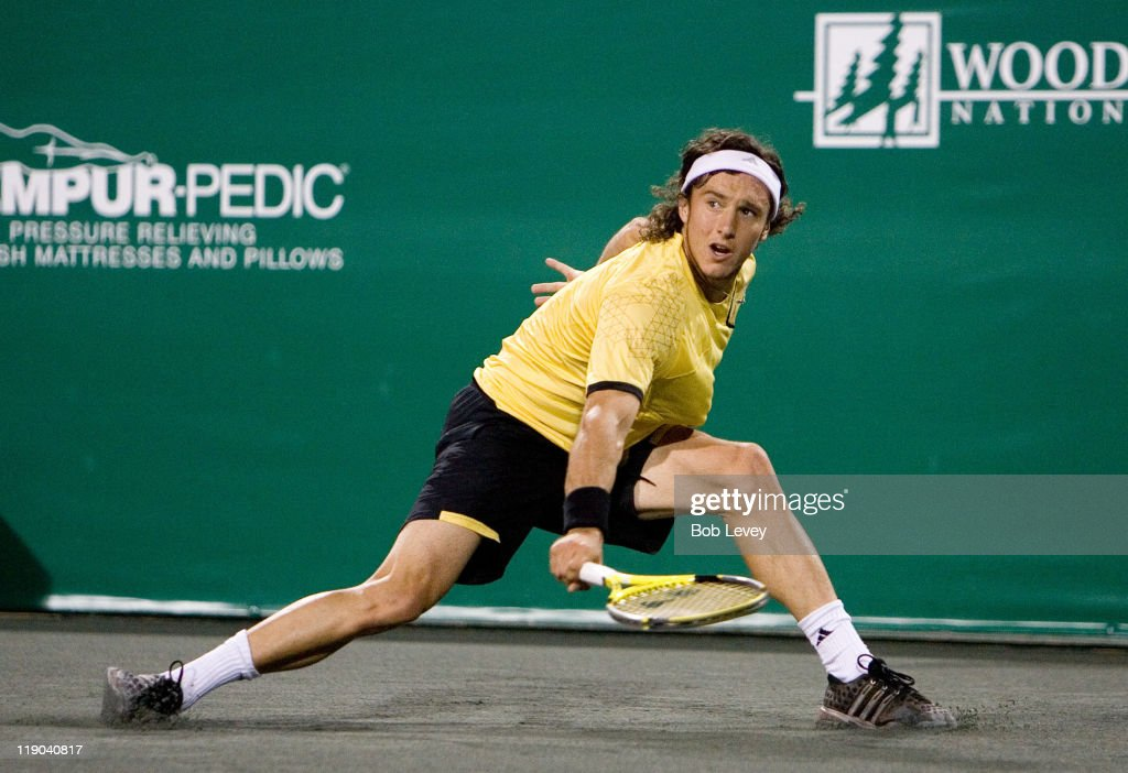 <a gi-track='captionPersonalityLinkClicked' href=/galleries/search?phrase=Juan+Monaco&family=editorial&specificpeople=238877 ng-click='$event.stopPropagation()'>Juan Monaco</a> (ARG) hits a return against <a gi-track='captionPersonalityLinkClicked' href=/galleries/search?phrase=Jan-Michael+Gambill&family=editorial&specificpeople=211179 ng-click='$event.stopPropagation()'>Jan-Michael Gambill</a> (USA) during match action. <a gi-track='captionPersonalityLinkClicked' href=/galleries/search?phrase=Juan+Monaco&family=editorial&specificpeople=238877 ng-click='$event.stopPropagation()'>Juan Monaco</a> (ARG) defeated <a gi-track='captionPersonalityLinkClicked' href=/galleries/search?phrase=Jan-Michael+Gambill&family=editorial&specificpeople=211179 ng-click='$event.stopPropagation()'>Jan-Michael Gambill</a> (USA) 7-5,6-4 in during first round action at the U.S. Mens Clay Court Championships, April 9, 2007 in Houston,Texas.