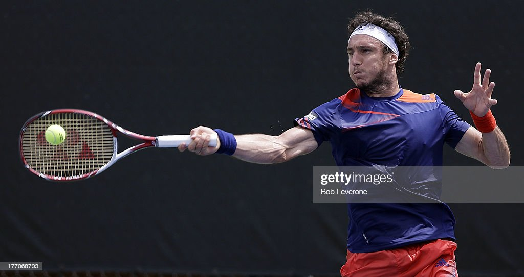 Juan Monaco of Aregentina hits a hard forehand to Nicolas Mahut of France on August 20, 2013 in Winston Salem, North Carolina.