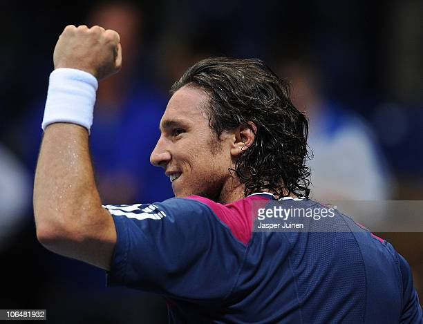 Juan Monaco of Argentina celebrates his win over Andy Murray of Great Britain in his second round match during the ATP 500 World Tour Valencia Open...