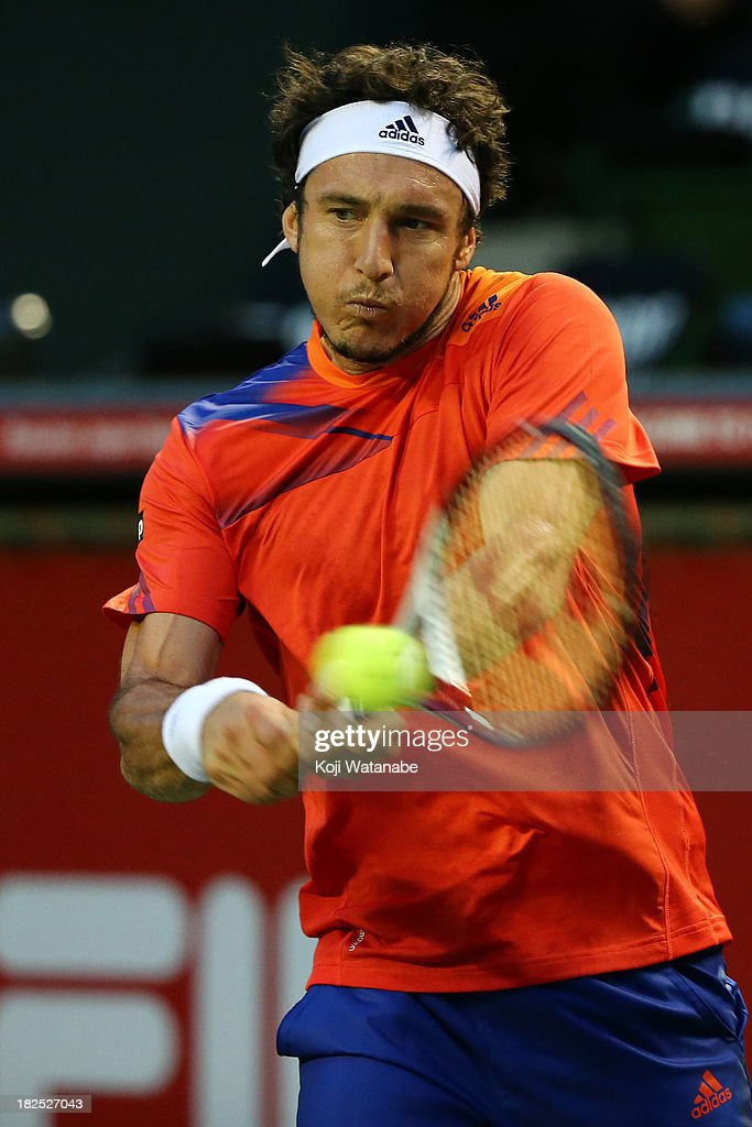 <a gi-track='captionPersonalityLinkClicked' href=/galleries/search?phrase=Juan+Monaco&family=editorial&specificpeople=238877 ng-click='$event.stopPropagation()'>Juan Monaco</a> of Argentina in action during his men's first round match against Jarkko Nieminen of Finland during day one of the Rakuten Open at Ariake Colosseum on September 30, 2013 in Tokyo, Japan.