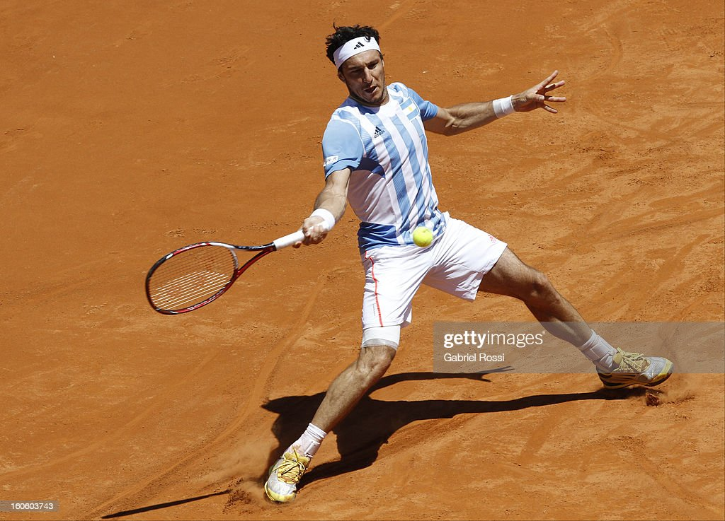 <a gi-track='captionPersonalityLinkClicked' href=/galleries/search?phrase=Juan+Monaco&family=editorial&specificpeople=238877 ng-click='$event.stopPropagation()'>Juan Monaco</a> of Argentina in action during the fourth match between Argentina and Germany in the first round of Copa Davis at the Parque Roca Stadium on February 03, 2013 in Buenos Aires, Argentina.