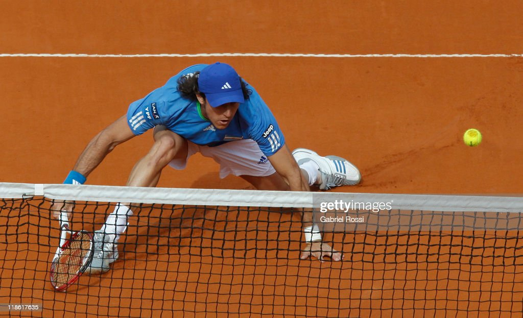 <a gi-track='captionPersonalityLinkClicked' href=/galleries/search?phrase=Juan+Monaco&family=editorial&specificpeople=238877 ng-click='$event.stopPropagation()'>Juan Monaco</a> of Argentina in action during the match between Argentina and Kazakhstan for third day in the quarters final of the Copa Davis at Parque Roca Stadium on July 08, 2011 in Buenos Aires, Argentina.