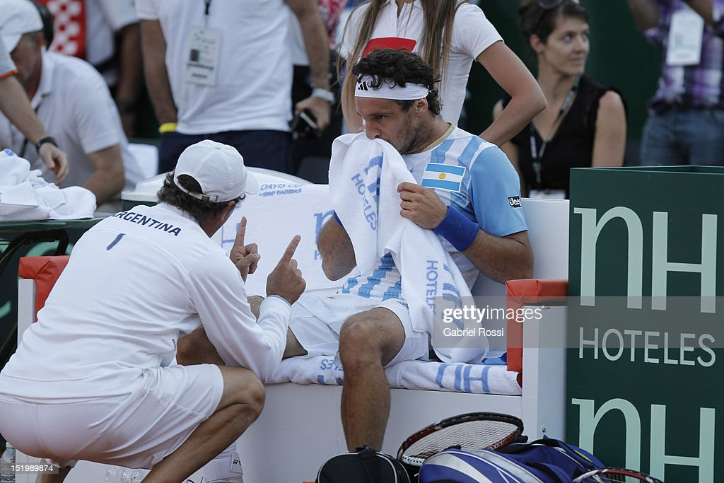 <a gi-track='captionPersonalityLinkClicked' href=/galleries/search?phrase=Juan+Monaco&family=editorial&specificpeople=238877 ng-click='$event.stopPropagation()'>Juan Monaco</a> of Argentina laments after beinmg defeated the second Davis Cup semi-final match between Argentina and Czech Republic at Mary Ter‡an de Weiss Stadium on September 14, 2012 in Buenos Aires, Argentina.
