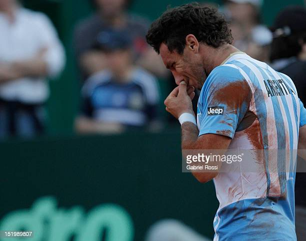 Juan Monaco of Argentina leaves the court after being defeated by Tomas Bedych during the second Davis Cup semifinal match between Argentina and...