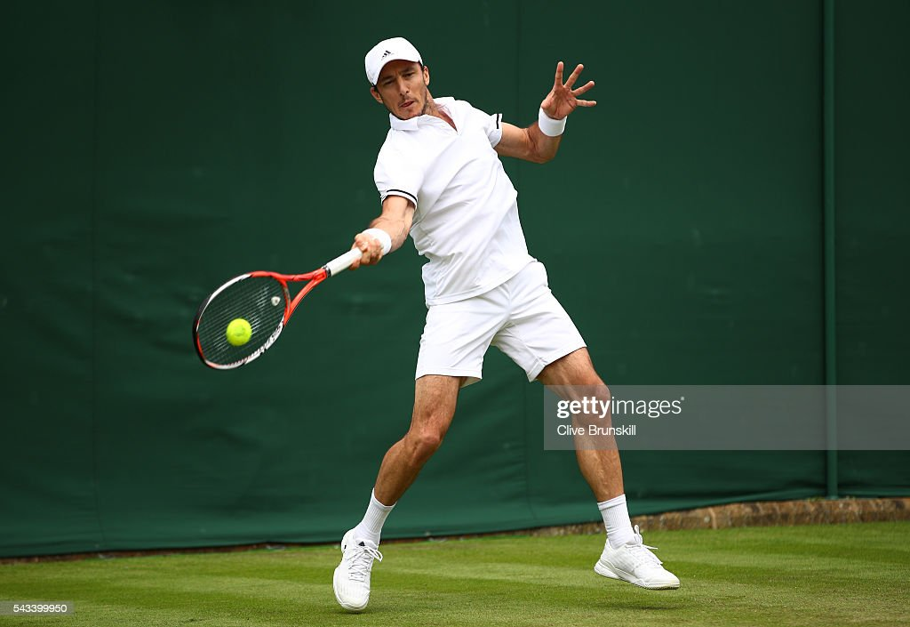 <a gi-track='captionPersonalityLinkClicked' href=/galleries/search?phrase=Juan+Monaco&family=editorial&specificpeople=238877 ng-click='$event.stopPropagation()'>Juan Monaco</a> of Argentina plays a forehand during the Men's Singles first round match against Taro Daniel of Japan on day two of the Wimbledon Lawn Tennis Championships at the All England Lawn Tennis and Croquet Club on June 28, 2016 in London, England.