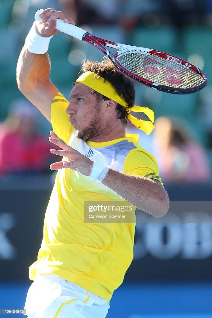 Juan Monaco of Argentina plays a forehand in his first round match against Andrey Kuznetsov of Russia during day one of the 2013 Australian Open at Melbourne Park on January 14, 2013 in Melbourne, Australia.