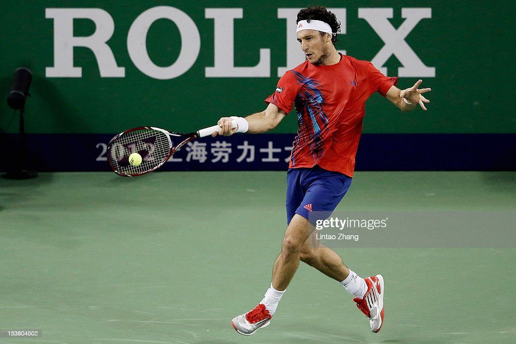 Juan Monaco of Argentina returns a shot to <a gi-track='captionPersonalityLinkClicked' href=/galleries/search?phrase=Fernando+Verdasco&family=editorial&specificpeople=213930 ng-click='$event.stopPropagation()'>Fernando Verdasco</a> of Spain during day three of Shanghai Rolex Masters at the Qi Zhong Tennis Center on October 9, 2012 in Shanghai, China.