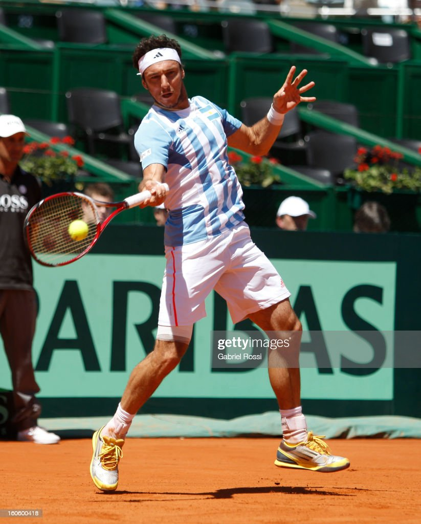 <a gi-track='captionPersonalityLinkClicked' href=/galleries/search?phrase=Juan+Monaco&family=editorial&specificpeople=238877 ng-click='$event.stopPropagation()'>Juan Monaco</a> of Argentina returns the ball to Kamke from Germany during the fourth match between Argentina and Germany in the first round of Copa Davis 2013 at the Parque Roca Stadium on February 03, 2013, Buenos Aires, Argentina.