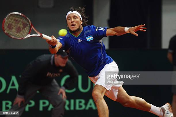 Juan Monaco of Argentina returns the ball to Philipp Petzschner of Germany on day 1 of the Davis Cup World Group first round match between Germany...