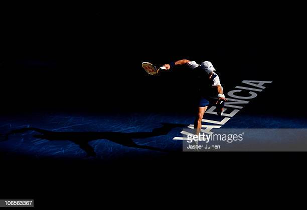 Juan Monaco of Argentina runs to play a backhand to Marcel Granollers of Spain in his quarter final match during the ATP 500 World Tour Valencia Open...