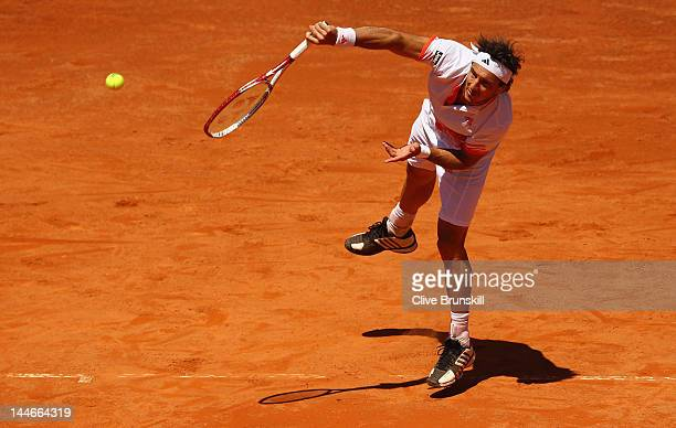 Juan Monaco of Argentina serves against Novak Djokovic of Serbia in their third round match during day six of the Internazionali BNL d'Italia 2012 at...