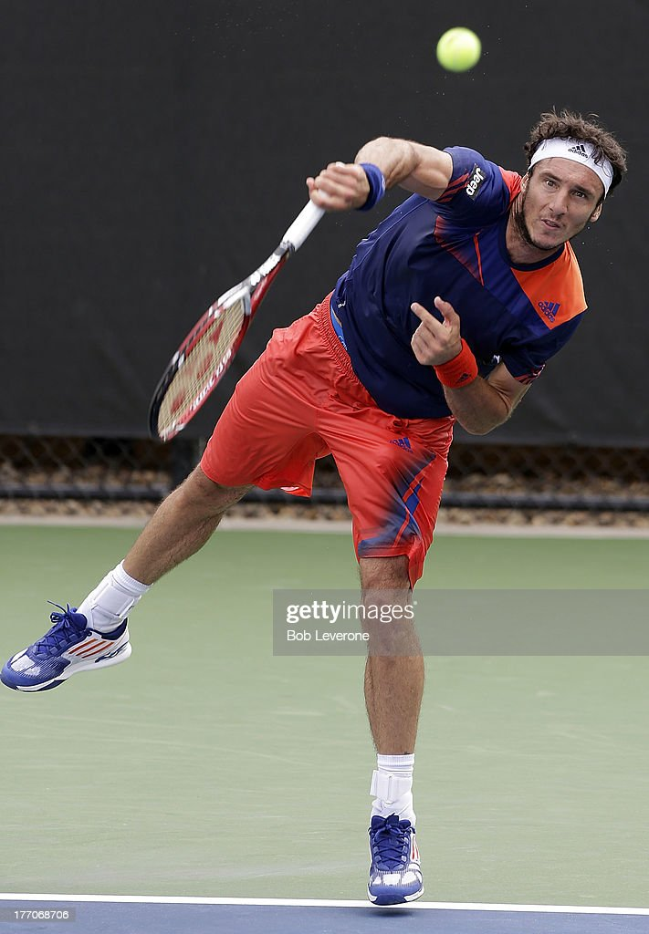 Juan Monaco of Argentina serves to France's Nicolas Mahut on August 20, 2013 in Winston Salem, North Carolina.