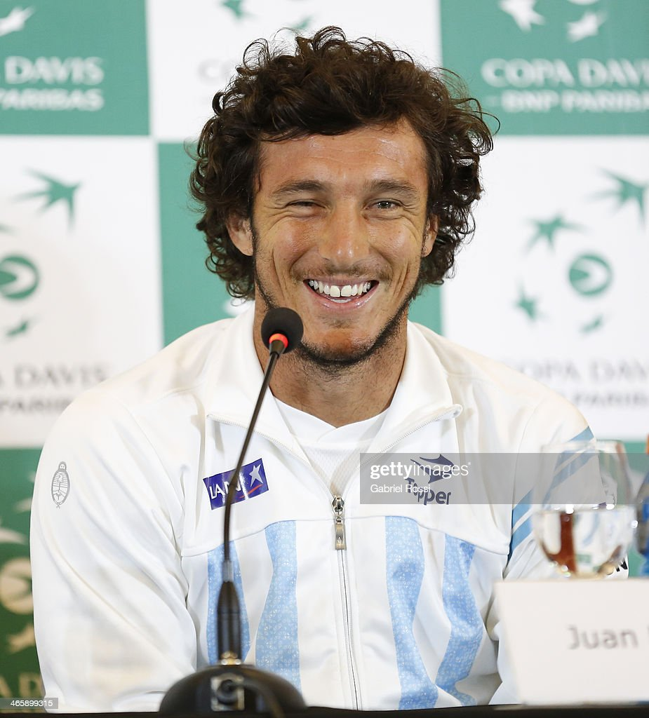 <a gi-track='captionPersonalityLinkClicked' href=/galleries/search?phrase=Juan+Monaco&family=editorial&specificpeople=238877 ng-click='$event.stopPropagation()'>Juan Monaco</a> of Argentina smiles during a press conference as part of the Copa Davis Draw between Argentina and Italy at NH Hotel on January 30, 2014 in Buenos Aires, Argentina.