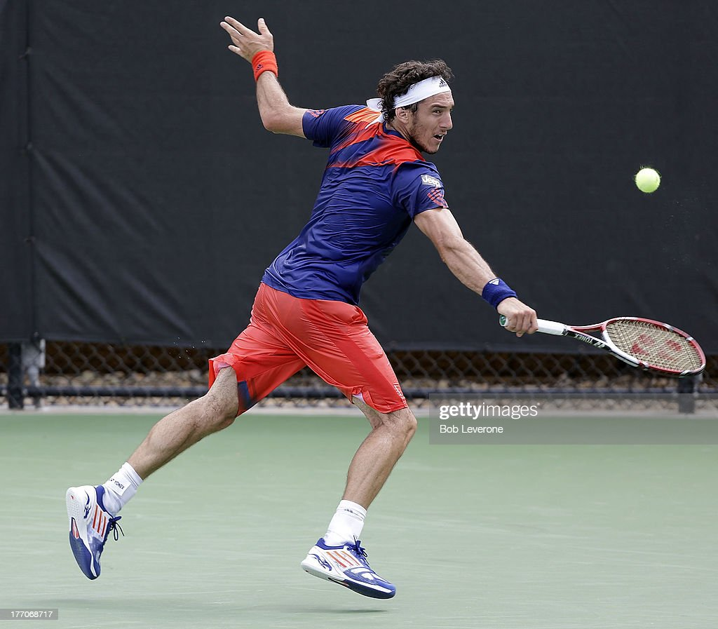 <a gi-track='captionPersonalityLinkClicked' href=/galleries/search?phrase=Juan+Monaco&family=editorial&specificpeople=238877 ng-click='$event.stopPropagation()'>Juan Monaco</a> of Argentina stretches to hit a return to France's Nicolas Mahut on August 20, 2013 in Winston Salem, North Carolina.