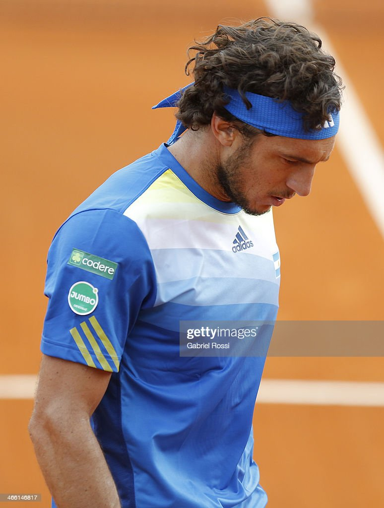 <a gi-track='captionPersonalityLinkClicked' href=/galleries/search?phrase=Juan+Monaco&family=editorial&specificpeople=238877 ng-click='$event.stopPropagation()'>Juan Monaco</a> of Argentine looks defeated during a match between Argentina and Italy as part of the Davis Cup at Patinodromo Stadium on January 31, 2014 in Mar del Plata, Argentina.