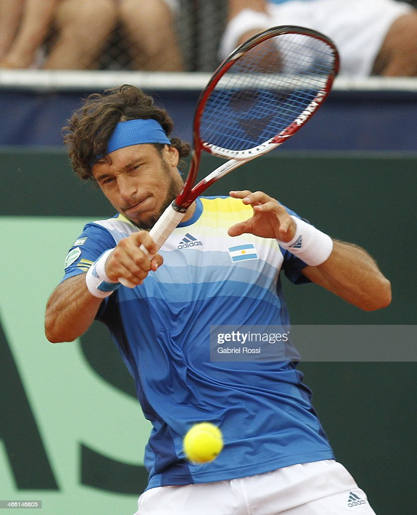 <a gi-track='captionPersonalityLinkClicked' href=/galleries/search?phrase=Juan+Monaco&family=editorial&specificpeople=238877 ng-click='$event.stopPropagation()'>Juan Monaco</a> of Argentine makes a shot during a match between Argentina and Italy as part of the Davis Cup at Patinodromo Stadium on January 31, 2014 in Mar del Plata, Argentina.