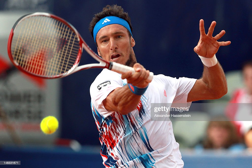 <a gi-track='captionPersonalityLinkClicked' href=/galleries/search?phrase=Juan+Monaco&family=editorial&specificpeople=238877 ng-click='$event.stopPropagation()'>Juan Monaco</a> of Argentinia plays a forehand during his semi finale match against Guillermo Garcia-Lopez of Spain during the Mercedes Cup 2012 at the TC Weissenhof on July 14, 2012 in Stuttgart, Germany.