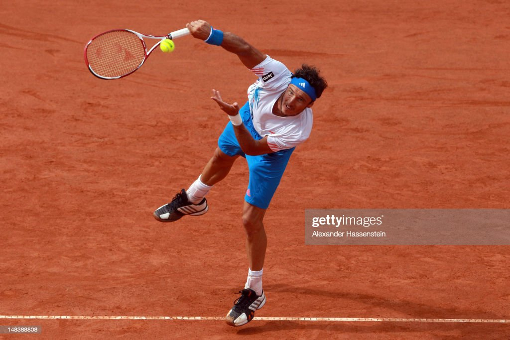 Juan Monaco of Argentinia serves during his finale match against Janko Tipsarevic of Serbia during day 6 of Mercedes Cup 2012 at the TC Weissenhof on July 15, 2012 in Stuttgart, Germany.